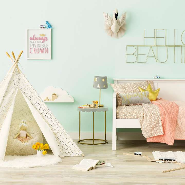 A Twin Bed And A Teepee With Wall Decor And Plush Toys From The Royal Retreat